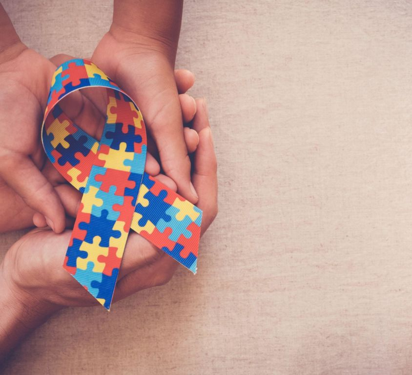 Hands,Holding,Puzzle,Ribbon,For,World,Autism,Spectrum,Disorder,Awareness